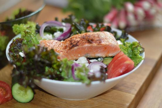 green salad and fish helps to promote bowel health